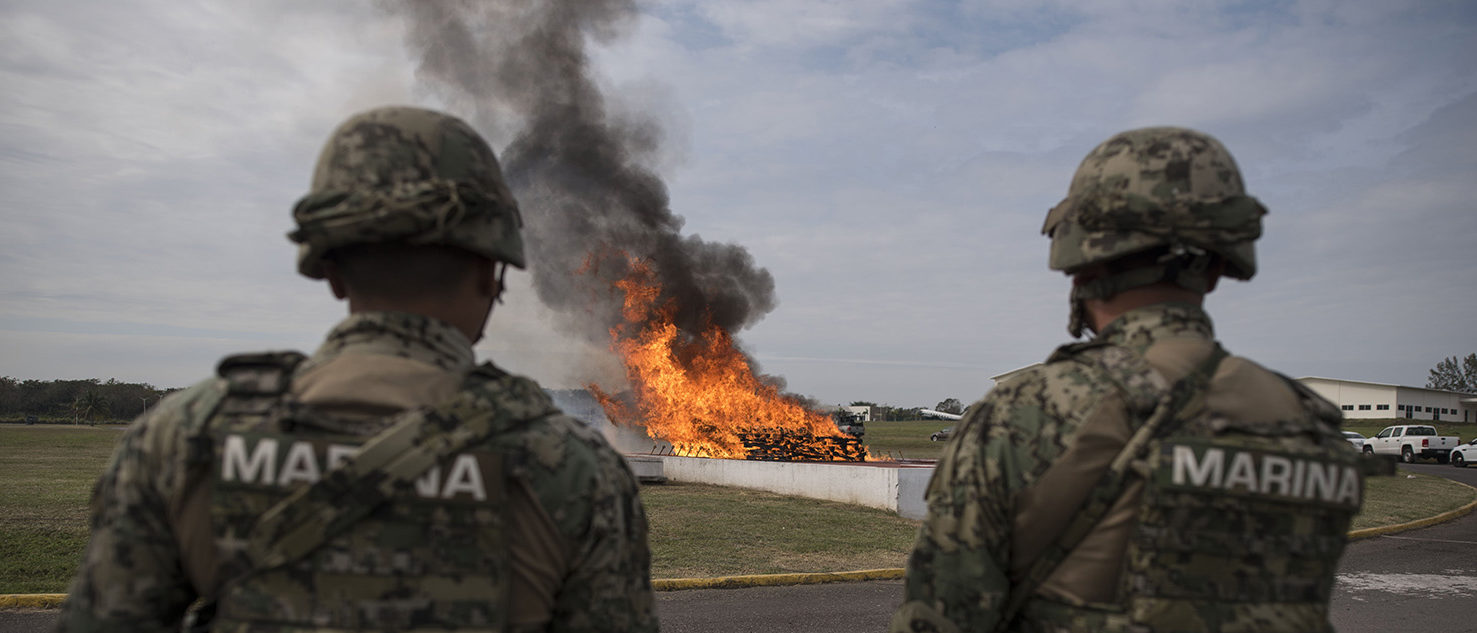 Mexican marines observe the burning of more than four hundred kilos of cocaine that were seized in the port city of Veracruz, in this Mexican city, on January, 16, 2018. Navy, Federal and Criminal Investigation Agency authorities witnessed the incineration of the drug - valued at five million dollars. VICTORIA RAZO/AFP/Getty Images