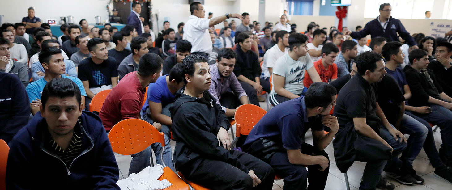 Deportees wait to be process at an immigration facility after a flight carrying illegal immigrants from the U.S. arrived in San Salvador, El Salvador, January 11, 2018. Picture taken January 11, 2018. REUTERS/Jose Cabezas