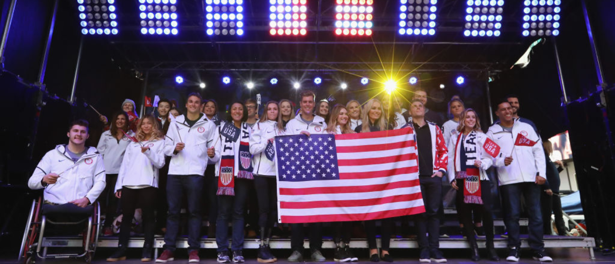 NEW YORK, NY - NOVEMBER 01: Bobsledder Elana Meyers Taylor, snowboarder Alex Deibold, skier Lindsey Vonn, skier Gus Kenworthy, figure skater Ashley Wagner and Team USA pose for a portrait during the 100 Days Out 2018 PyeongChang Winter Olympics Celebration - Team USA in Times Square on November 1, 2017 in New York City. (Photo by Abbie Parr/Getty Images)
