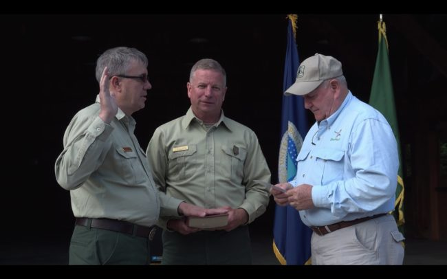 Tony Tooke sworn in by Agriculture Secretary Sonny Perdue as U.S. Forest Service chief. Photo: Screenshot/USDA/YouTube)