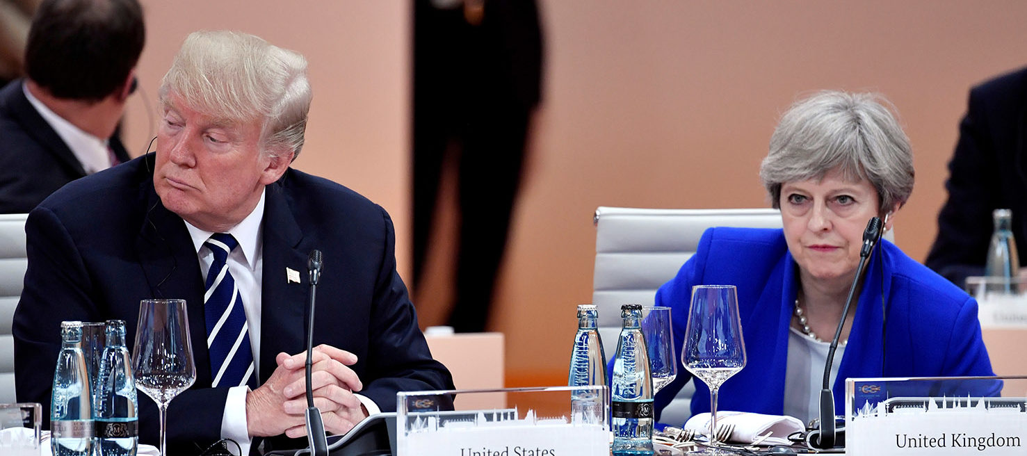 US President Donald Trump and Britain's Prime Minister Theresa May wait at the start of the first working session of the G20 meeting in Hamburg, Germany, July 7, 2017. REUTERS/John MACDOUGALL/Pool/File Photo
