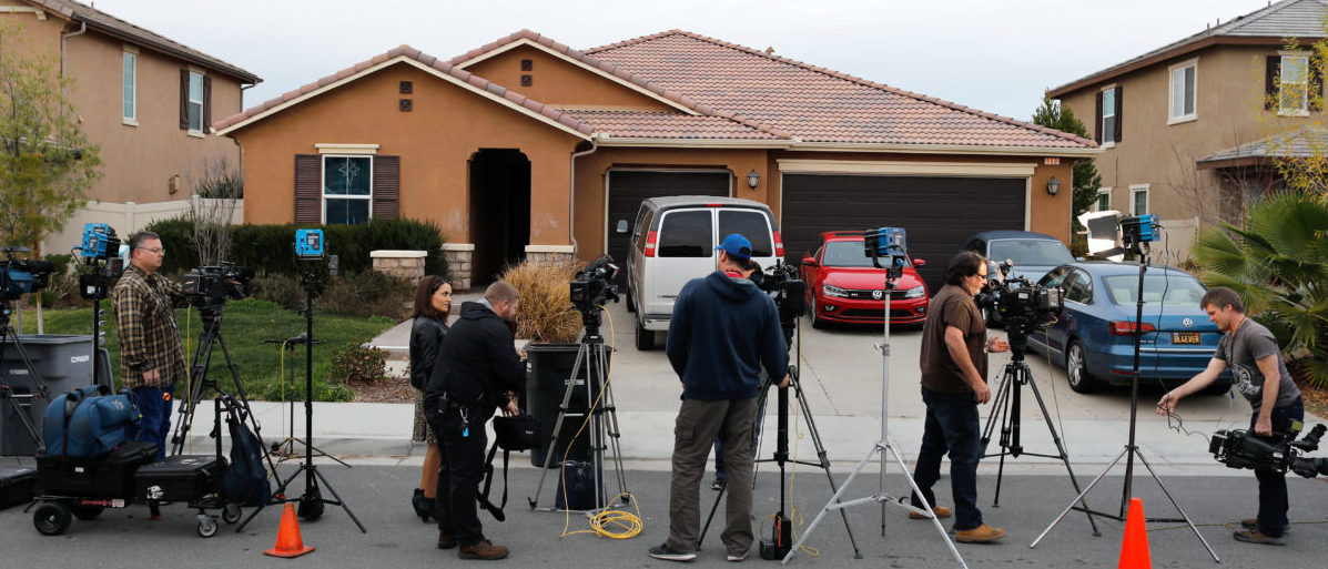 Members of the news media stand outside the home of David Allen Turpin and Louise Ann Turpin in Perris, California, U.S. January 15, 2018. REUTERS/Mike Blake