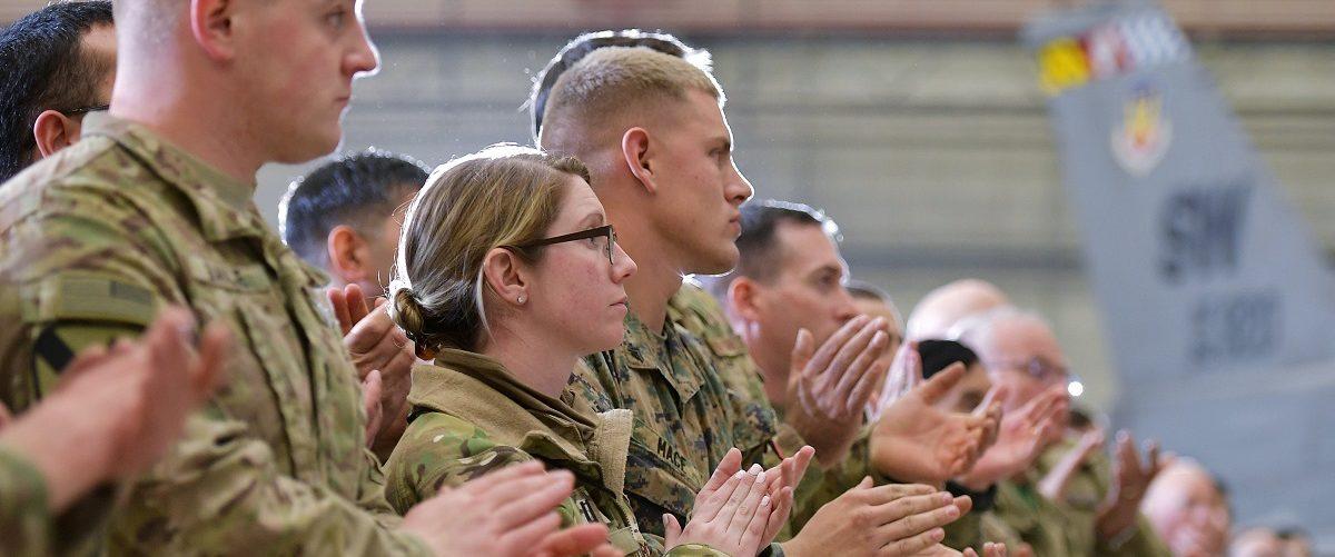 Troops applaud as U.S. Vice President Mike Pence speaks in a hangar at Bagram Air Field in Afghanistan