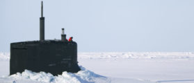 A US Navy sailor looks off the bridge of the Seawolf class submarine USS Connecticut after surfacing through Arctic sea ice during an exercise near the 2011 Applied Physics Laboratory Ice Station north of Prudhoe Bay, Alaska March 18, 2011. REUTERS/Lucas Jackson