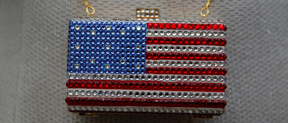 Elsie Gufler, California co-chair of Women For Ted Cruz For President, wears an American-flagg themed purse during the California GOP convention in Burlingame, California, U.S., April 30, 2016. REUTERS/Stephen Lam
