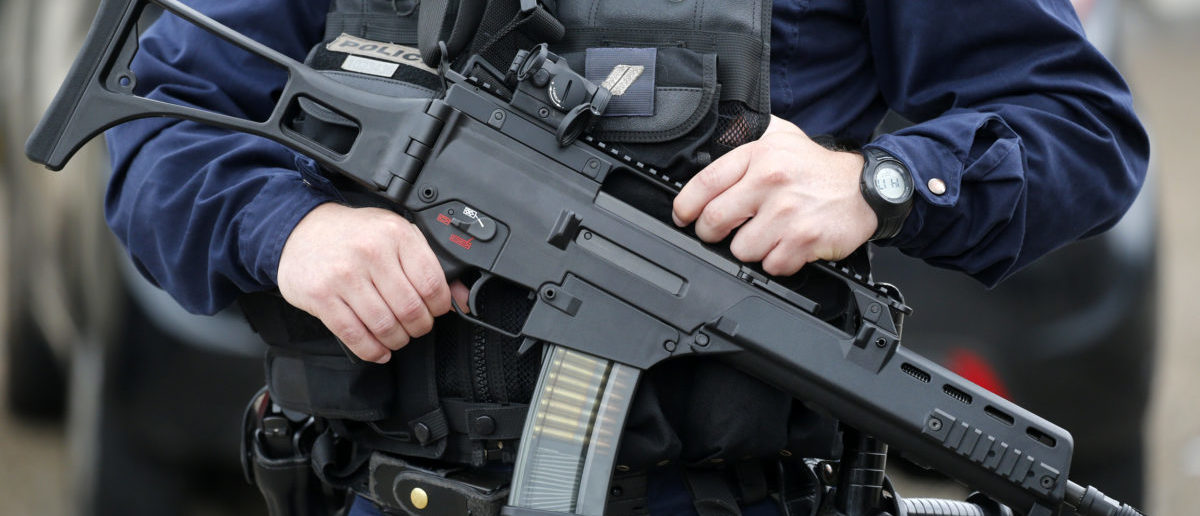 A policeman holds a HKG36 assault rifle as he secures the position in front of the city hall after two assailants had taken five people hostage in the church at Saint-Etienne-du-Rouvray near Rouen in Normandy, France, July 26, 2016. Two attackers killed a priest with a blade and seriously wounded another hostage in a church in northern France on Tuesday before being shot dead by French police. REUTERS/Pascal Rossignol