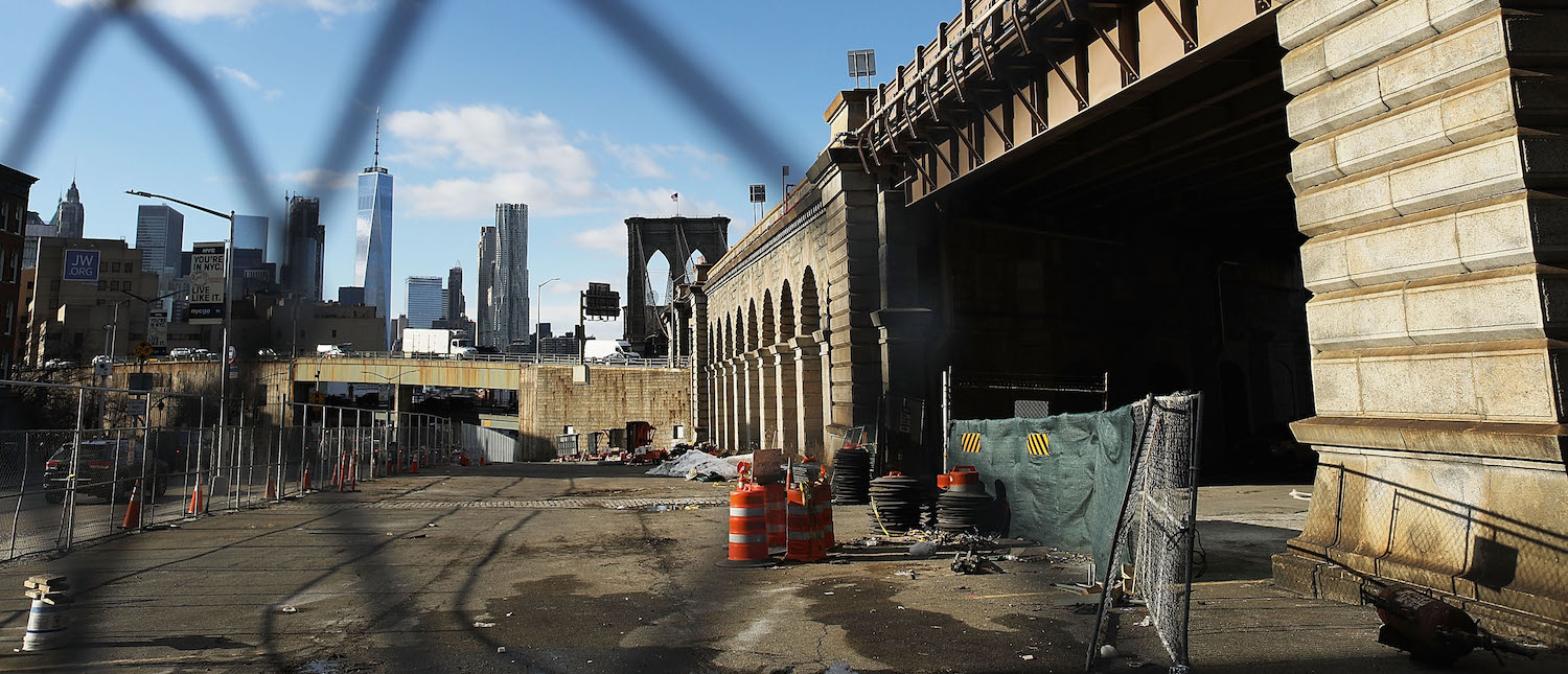 A work site stands next to the Brooklyn Bridge on February 16, 2017 in New York City. An annual report by the American Road and Transportation Builders Association (ARTBA) notes that there are now nearly 56,000 bridges nationwide that are structurally deficient. (Photo by Spencer Platt/Getty Images)