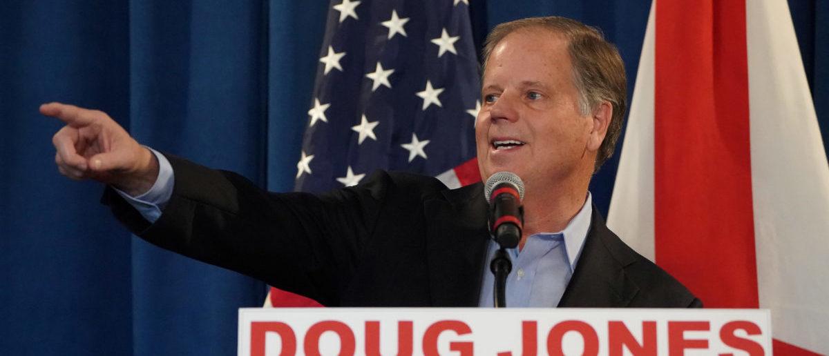 Democratic Senator-elect Doug Jones holds a press briefing in Birmingham, Alabama, U.S., December 13, 2017. REUTERS/Carlo Allegri