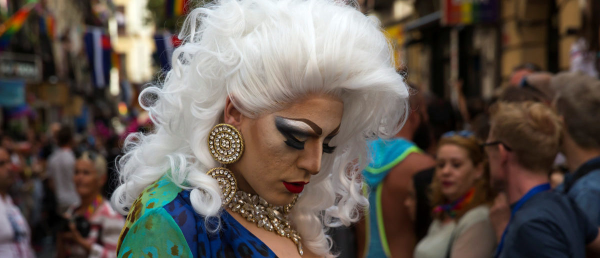 A drag queen walks during the annual race on high heels during World Pride celebrations in the quarter of Chueca in Madrid, Spain, June 29, 2017. REUTERS/Juan Medina