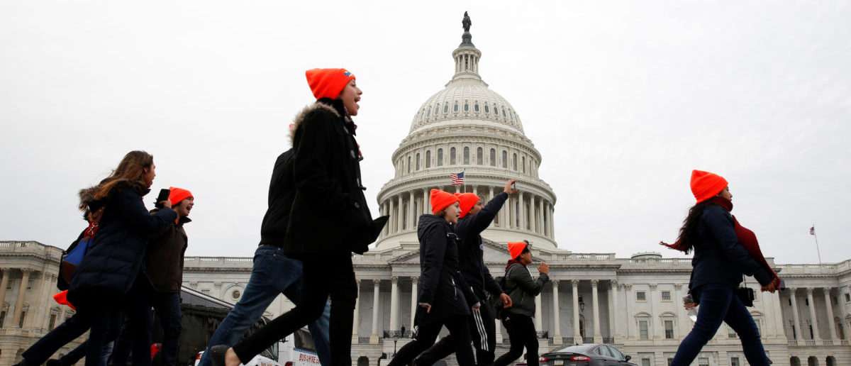 Protesters who call for an immigration bill addressing the so-called Dreamers, young adults who were brought to the United States as children, rally on Capitol Hill in Washington, U.S., December 20, 2017. REUTERS/Joshua Roberts