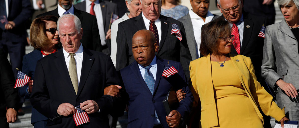Rep. Mike Thompson (D-CA), Rep. John Lewis (D-GA) and Rep. Robin Kelly (D-IL) arrive at a news conference about the recent shooting in Las Vegas outside the Capitol Building in Washington, U.S., October 4, 2017. REUTERS/Aaron P. Bernstein
