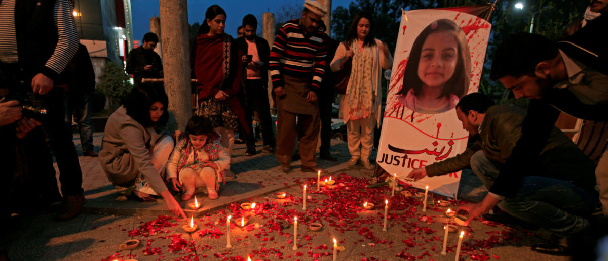 FILE PHOTO: Members of Civil Society light candles and earthen lamps to condemn the rape and murder of 7-year-old girl Zainab Ansari in Kasur, during a candlelight vigil in Islamabad, Pakistan January 11, 2018. REUTERS/Faisal Mahmood