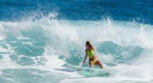 Hamilton looks flawless rocking a neon yellow bikini while riding the waves. (Photo: Instagram)