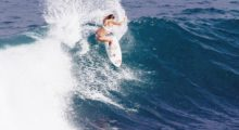 Hamilton looks like a surf god in this shot wearing a bikini while surfing. (Photo: Instagram)