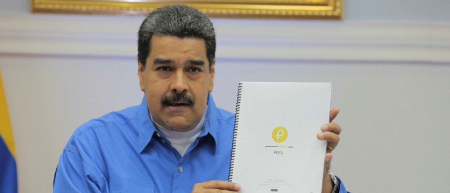 FILE PHOTO: Venezuela's President Nicolas Maduro holds a document as he speaks during a meeting with ministers in Caracas, Venezuela January 30, 2018. Miraflores Palace/Handout via REUTERS