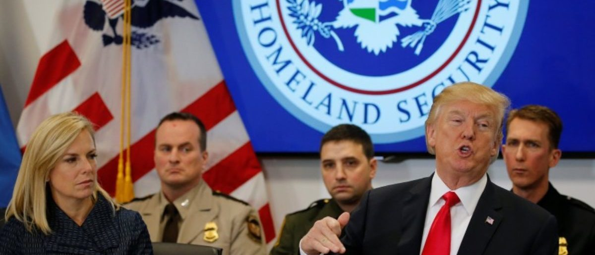 U.S. President Donald Trump, flanked by Secretary of Homeland Security Kirstjen Nielsen (L), holds a meeting at the U.S. Customs and Border Protection's National Targeting Center in Sterling, Virginia, U.S. February 2, 2018. REUTERS/Jonathan Ernst
