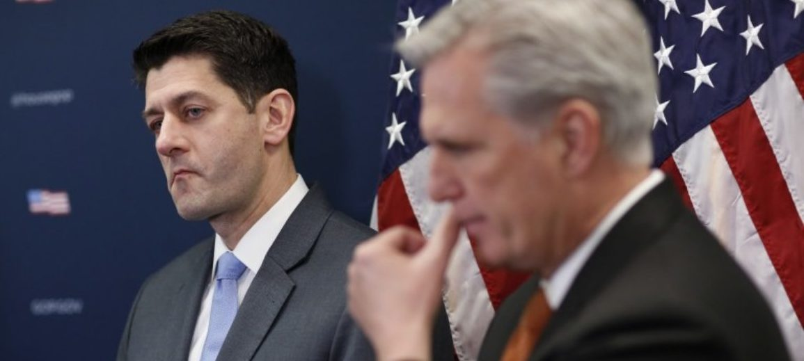 U.S. House Speaker Paul Ryan (R-WI) listens next to House Majority Leader Kevin McCarthy (R-CA) during a news conference ahead of an expected vote in the Republican-led U.S. House of Representatives on a short-term budget measure that would avert a rerun of last month's three-day partial government shutdown, on Capitol Hill in Washington, February 6, 2018. REUTERS/Joshua Roberts