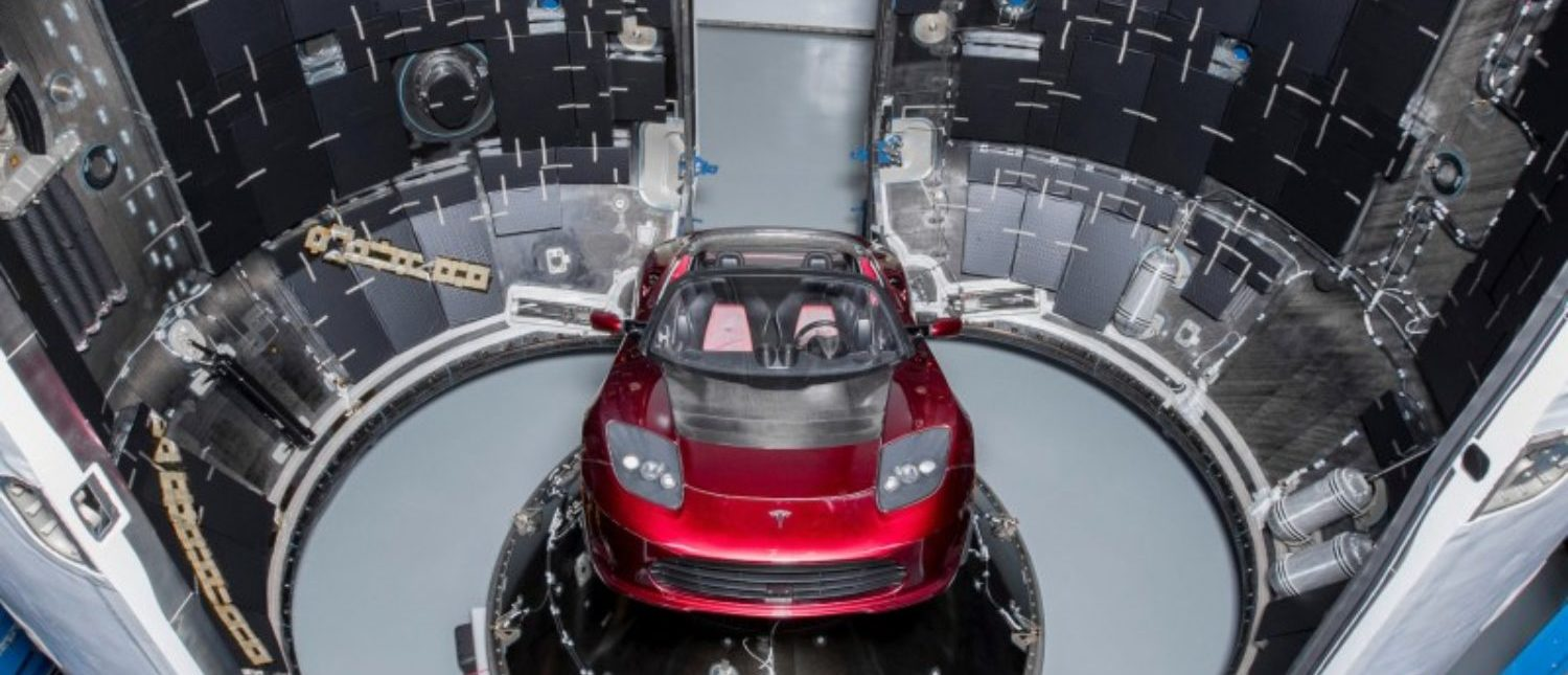 A red Tesla Roadster is seen during preparations to use it as a mock payload for the launch of a SpaceX Falcon Heavy rocket, in Cape Canaveral, Florida, U.S. December 6, 2017. Flickr.com/photos/SpaceX via REUTERS