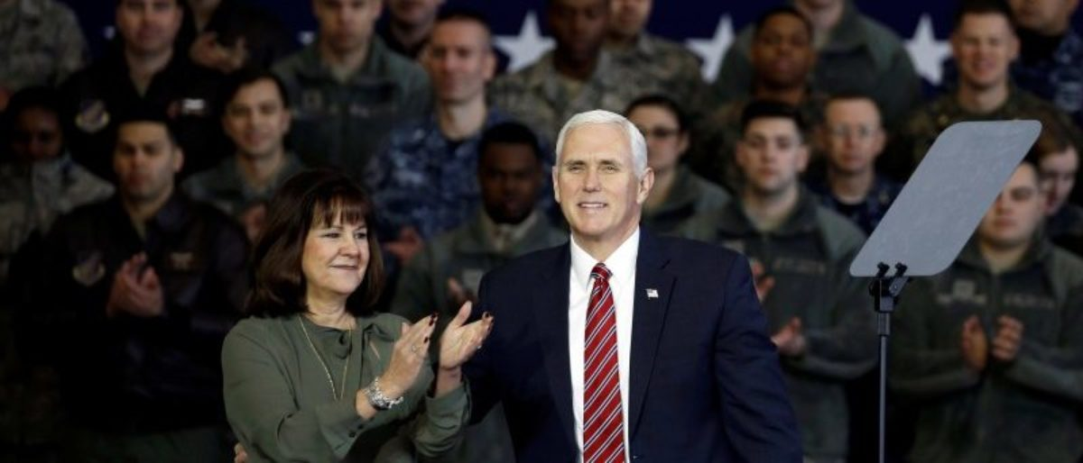 U.S. Vice President Mike Pence arrives with his wife Karen to address members of U.S. military services and Japan Self-Defense Force (JSDF) before he departs for South Korea, at U.S. Air Force Yokota base in Fussa, on the outskirts of Tokyo, Japan, February 8, 2018. REUTERS/Toru Hanai