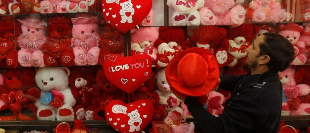 A shopkeeper hangs newly arrived stock at his shop ahead of Valentine's day in Peshawar, Pakistan February 7, 2018. REUTERS/Fayaz Aziz