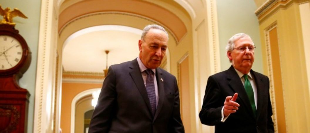 U.S. Senate Minority Leader Chuck Schumer (D-NY) and U.S. Senate Majority Leader Mitch McConnell (R-KY) walk to the Senate chamber on Capitol Hill in Washington, D.C., U.S., February 7, 2018. REUTERS/Eric Thayer?