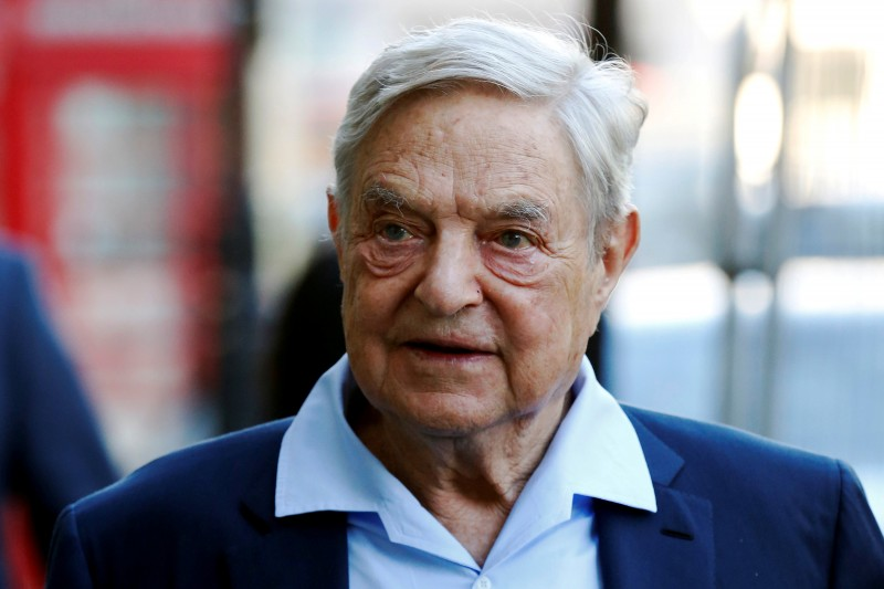 FILE PHOTO: Business magnate George Soros arrives to speak at the Open Russia Club in London, Britain June 20, 2016. REUTERS/Luke MacGregor/File Photo