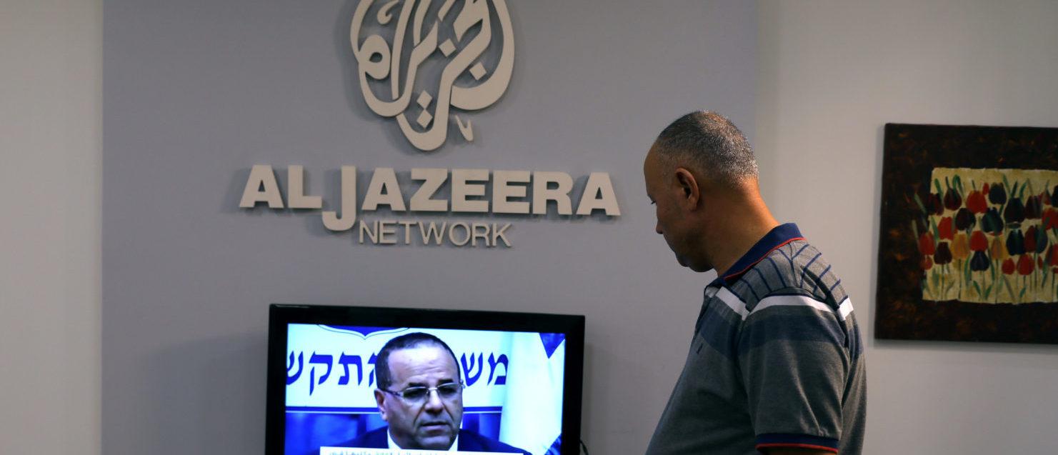 An employee working inside the office of Qatar-based Al-Jazeera network in Jerusalem August 7, 2017. REUTERS/Ammar Awad