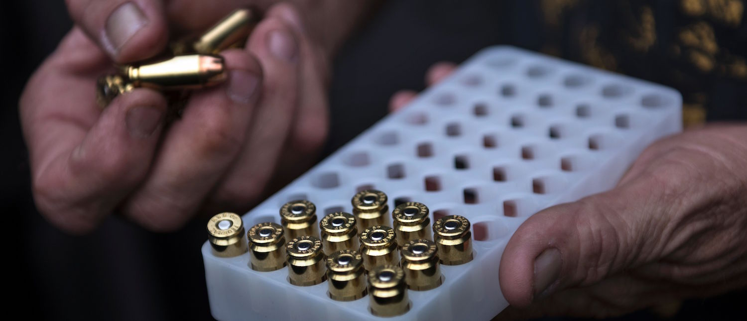 A member of the Georgia Security Force III% militia gathers 9mm ammunition before practicing shooting during a field training exercise July 28, 2017 in Jackson, Georgia. (Photo: BRENDAN SMIALOWSKI/AFP/Getty Images)
