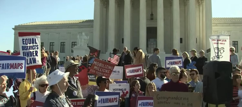 Anti-gerrymandering protestors at the Supreme Court in 2017. (YouTube screenshot/CBS)