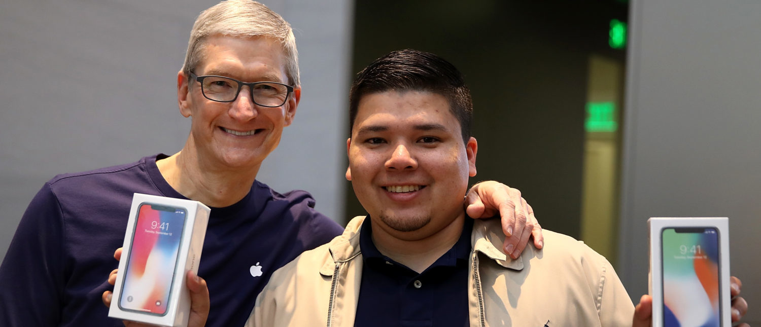 PALO ALTO, CA - NOVEMBER 03: Apple CEO Tim Cook (L) takes a picture with David Casarez (R) who just purchased the new iPhone X at an Apple Store on November 3, 2017 in Palo Alto, California. The highly anticipated iPhone X went on sale around the world today. (Photo by Justin Sullivan/Getty Images)