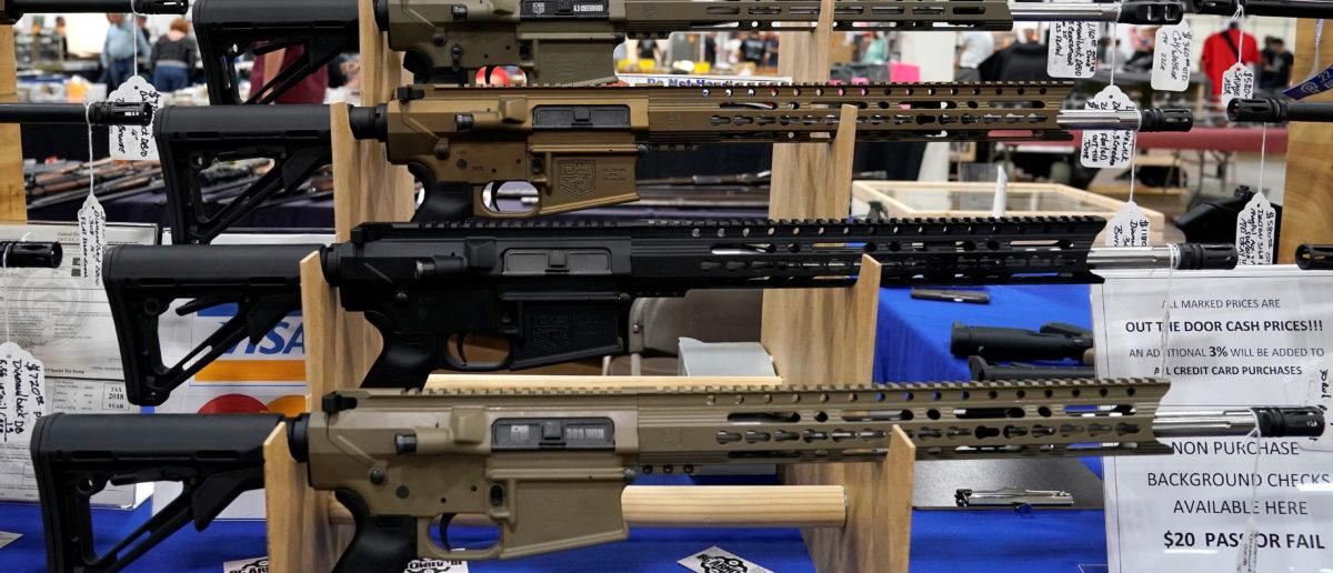 AR-15 rifles are displayed for sale at the Guntoberfest gun show in Oaks, Pennsylvania, U.S., October 6, 2017.   REUTERS/Joshua Roberts - RC1194FCFC70