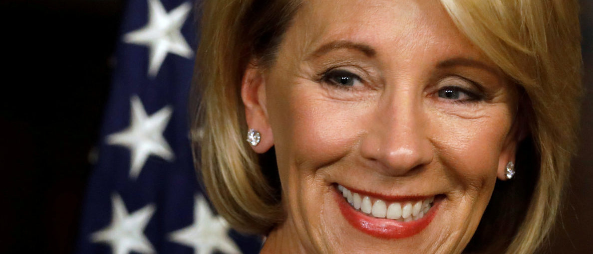 Betsy DeVos waits to be sworn-in as U.S. Education Secretary at the Eisenhower Executive Office Building at the White House in Washington, U.S. February 7, 2017. REUTERS/Jonathan Ernst