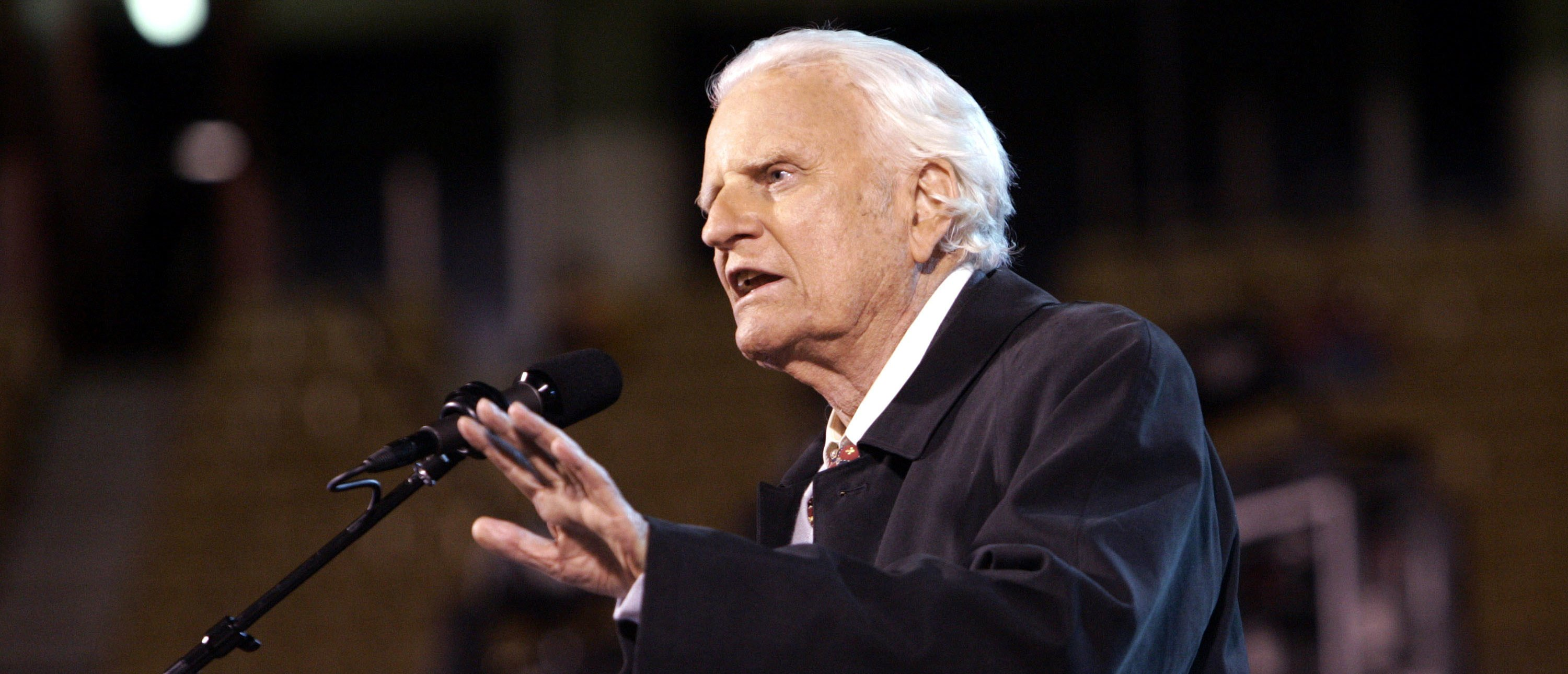 The Rev. Billy F. Graham speaks to the crowd on a rainy night October 7, 2004 at Arrowhead Stadium in Kansas City, Missouri. (Photo by Larry W. Smith/Getty Images)