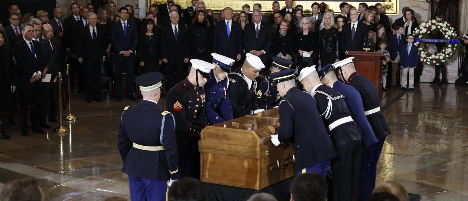 U.S. President Donald Trump (C), the Rev. Billy Graham's son Franklin Graham (center, R), first lady Melania Trump (center, L) and Vice President Mike Pence (center, L) look on as members of the U.S. military carry the casket during ceremonies in the U.S. Capitol Rotunda as the remains of the late Rev. Billy Graham lie in honor in Washington, U.S. February 28, 2018. REUTERS/Leah Millis