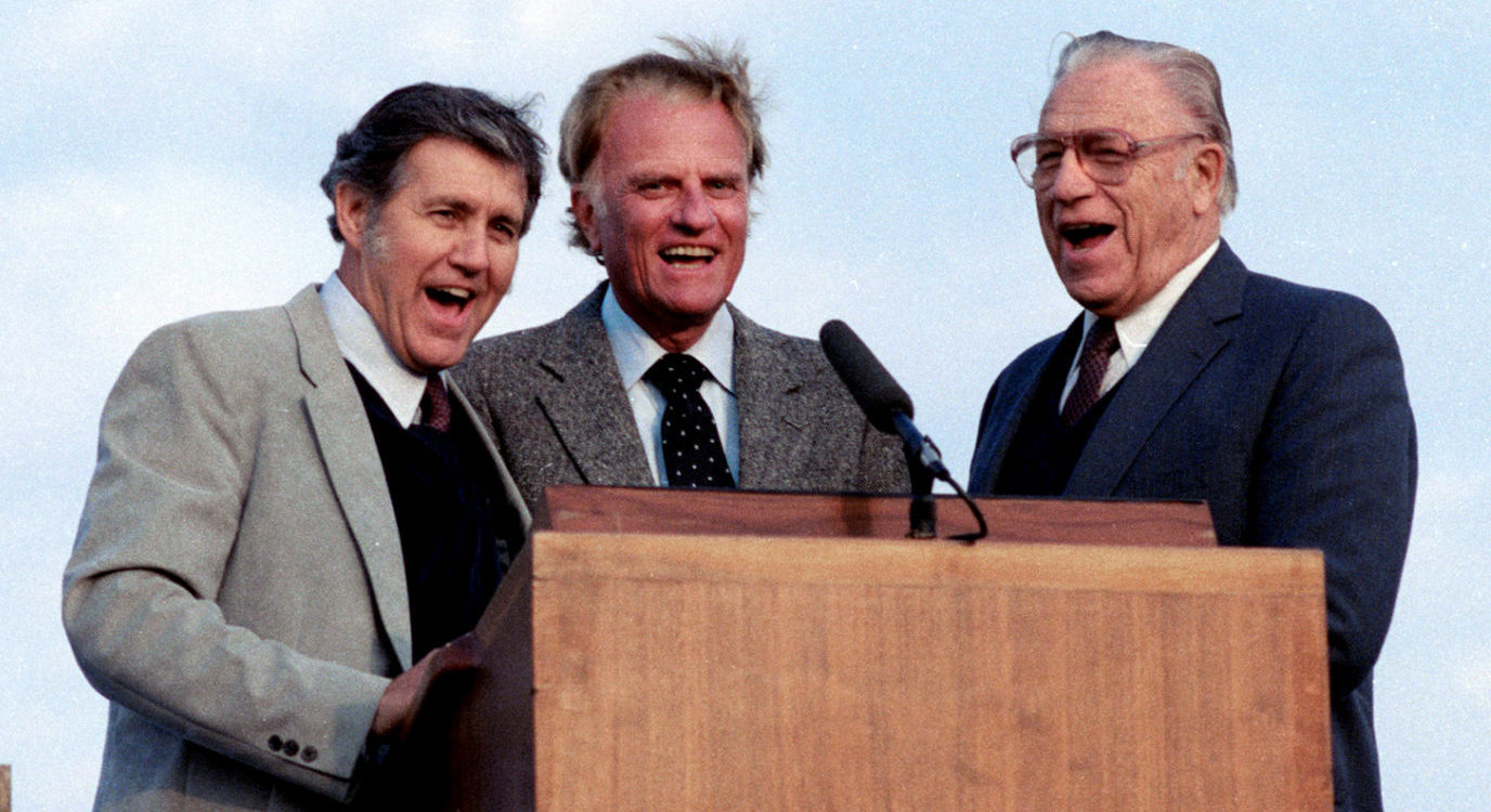 FILE PHOTO: L-R; Cliff Barrows, Rev. Billy Graham and George Beverly Shea sing