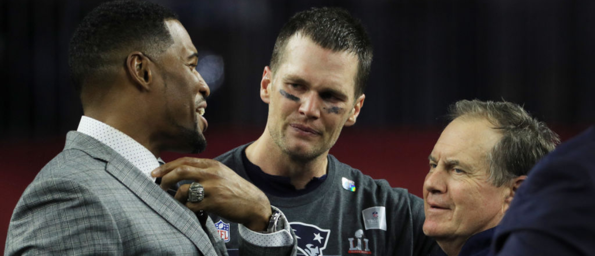 HOUSTON, TX - FEBRUARY 05: Michael Strahan, Tom Brady #12 and head coach Bill Belichick of the New England Patriots reacts after defeating the Atlanta Falcons 34-28 in overtime during Super Bowl 51 at NRG Stadium on February 5, 2017 in Houston, Texas. (Photo by Mike Ehrmann/Getty Images)