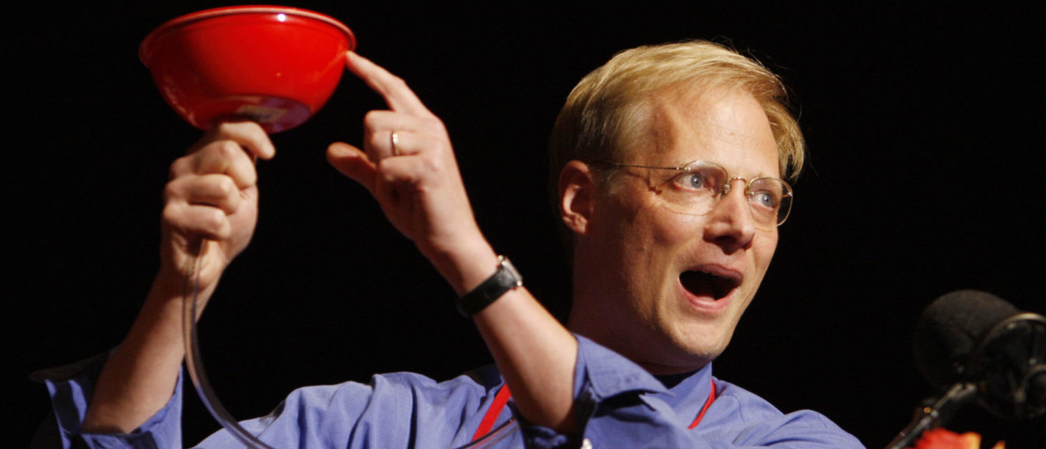 Brian Wansink of Cornell University demonstrates his 'bottomless bowl of soup' after he was awarded a 2007 Ig Nobel Prize, 04 October 2007, at Harvard University in Cambridge, Massachusetts. Wansink explored the seemingly boundless appetites of human beings, by feeding them with a self-refilling, bottomless bowl of soup. The prizes are given by the Harvard-based science humor magazine 'Annals of Improbable Research' and honor 'achievements that first make people laugh, and then make them think'. Prizes were also given for research about a literally-bottomless bowl of soup, a 'gay bomb', a net that drops on bank robbers and vanilla made from cow dung. AFP PHOTO/Stan HONDA (Photo credit should read STAN HONDA/AFP/Getty Images)