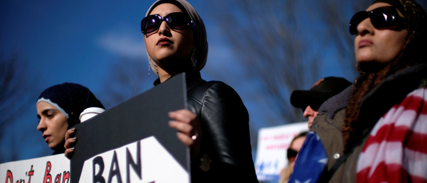 Activist groups including the Council on American-Islamic Relations, MoveOn.org, Oxfam, and the ACLU hold a rally in front of the White House to mark the anniversary of the first Trump administration travel and refugee ban in Washington, U.S., January 27, 2018. REUTERS/James Lawler Duggan
