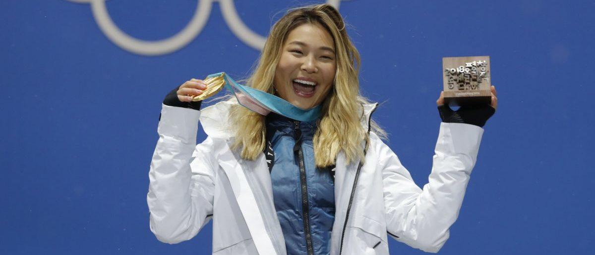 Medals Ceremony - Snowboarding - Pyeongchang 2018 Winter Olympics - Women's Halfpipe - Medals Plaza - Pyeongchang, South Korea - February 13, 2018 - Gold medalist Chloe Kim of the U.S. on the podium. REUTERS/Eric Gaillard