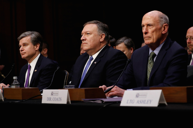 (L-R) FBI Director Christopher Wray, CIA Director Mike Pompeo, and Director of National Intelligence Dan Coats wait to testify before the Senate Intelligence Committee on Capitol Hill in Washington, February 13, 2018. REUTERS/Aaron P. Bernstein