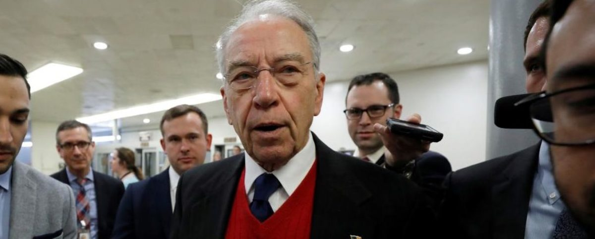 FILE PHOTO: Sen. Chuck Grassley speaks with reporters on Capitol Hill in Washington, U.S., December 6, 2017. REUTERS/Aaron P. Bernstein