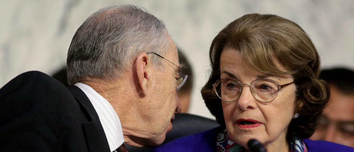Senate Judiciary Committee Chairman Chuck Grassley (R-IA) speaks to Senator Dianne Feinstein (D-CA) as U.S. Attorney General Jeff Sessions (not pictured) testifies before a Senate Judiciary oversight hearing on the Justice Department on Capitol Hill in Washington, U.S., October 18, 2017. REUTERS/Joshua Roberts