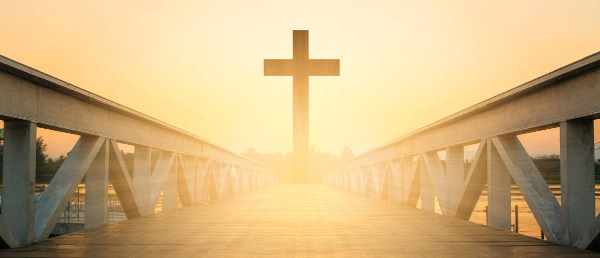 Cross on a bridge. (Shutterstock/somrak jendee)