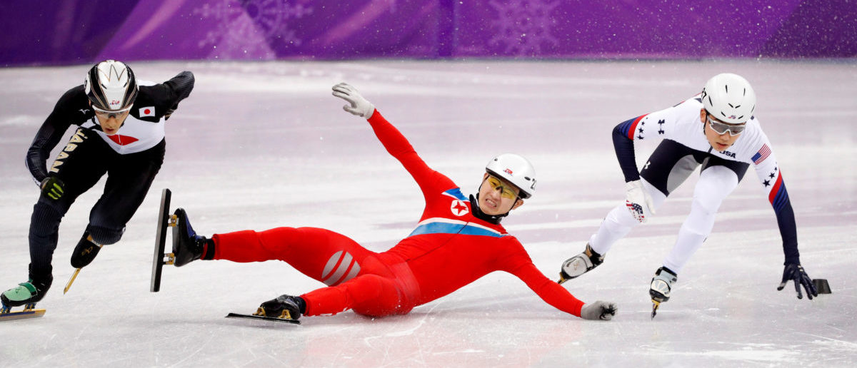 Short Track Speed Skating Events - Pyeongchang 2018 Winter Olympics - Men's 500 m Competition - Gangneung Ice Arena - Gangneung, South Korea - February 20, 2018. Keita Watanabe of Japan and Thomas Insuk Hong of the U.S in action as Jong Kwang Bom of North Korea falls. REUTERS/John Sibley
