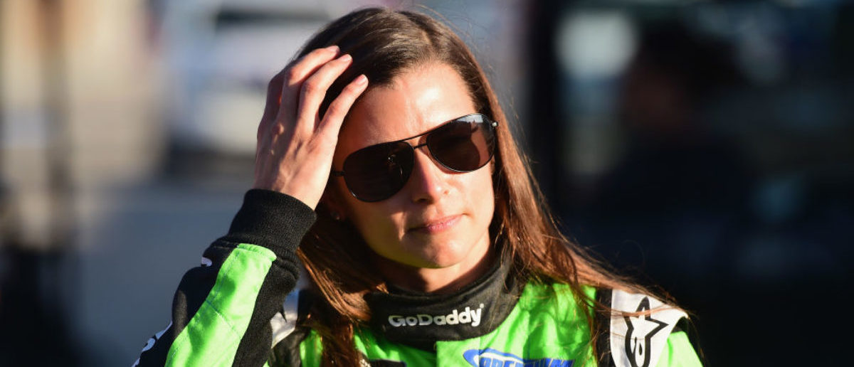 DAYTONA BEACH, FL - FEBRUARY 18: Danica Patrick, driver of the #7 GoDaddy Chevrolet, walks from the infield care center after being involved in an on-track incident the Monster Energy NASCAR Cup Series 60th Annual Daytona 500 at Daytona International Speedway on February 18, 2018 in Daytona Beach, Florida. (Photo by Jared C. Tilton/Getty Images)