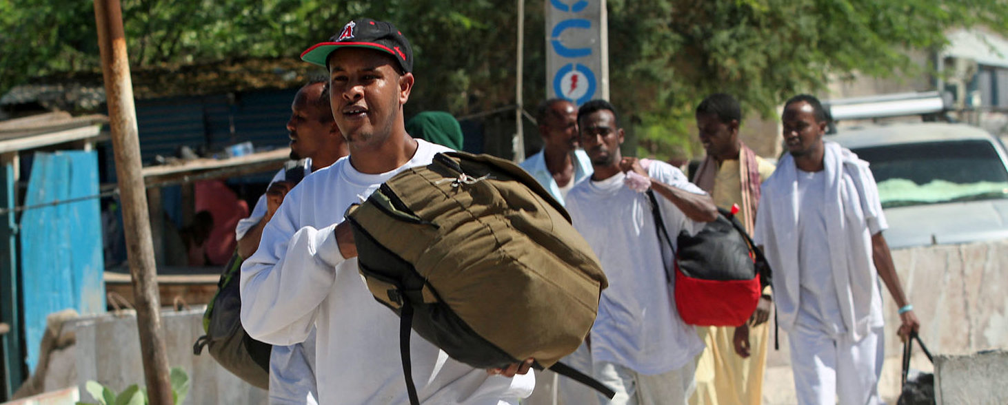 Somali deportees carry their luggage after arriving on a flight from the U.S. at the Adan Abdulle International Airport in Mogadishu, Somalia May 12, 2017. REUTERS/Feisal Omar
