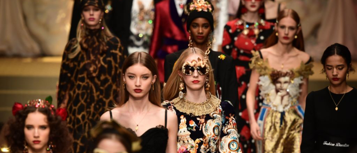Models present creations by Dolce & Gabbana during the women's Fall/Winter 2018/2019 collection fashion show in Milan, on February 25, 2018. / AFP PHOTO / Miguel MEDINA (Photo credit should read MIGUEL MEDINA/AFP/Getty Images)