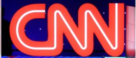 Donald Trump CNN logo Left: Photo by Tasos Katopodis/Getty Images Right: Photo by Scott Olson/Getty Images