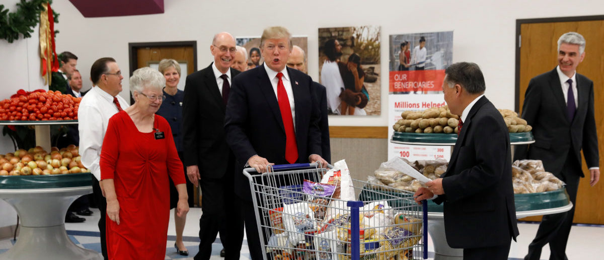U.S. President Donald Trump pushes a shopping cart as he visits the Church of Jesus Christ of Latter-Day Saints Welfare Square food distribution center in Salt Lake City, Utah, U.S.  December 4, 2017. REUTERS/Kevin Lamarque