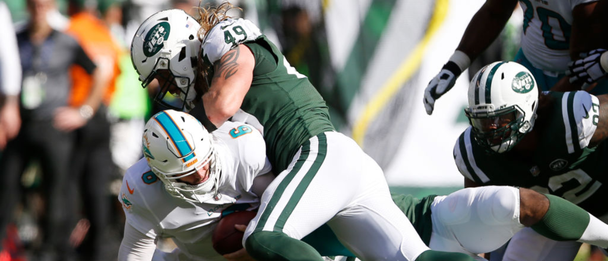 EAST RUTHERFORD, NJ - SEPTEMBER 24: Jay Cutler #6 of the Miami Dolphins is sacked by Dylan Donahue #49 of the New York Jets during the second half of an NFL game at MetLife Stadium on September 24, 2017 in East Rutherford, New Jersey. The New York Jets defeated the Miami Dolphins 20-6. (Photo by Rich Schultz/Getty Images)